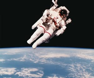 astronaut, dig it : a chair, and floating above earth image