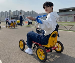 Seventeen, four wheeled rider, and s. coups image