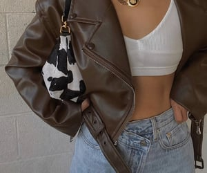 gold, jewerly, and leather jacket image