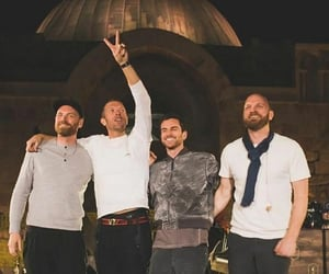 band, Chris Martin, and will champion image