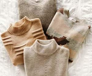 tan chunky turtleneck and mocha cable knit sweater image
