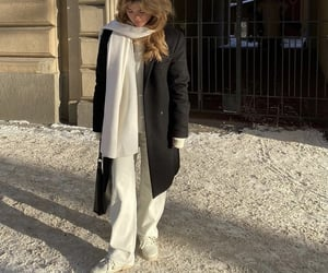 black coat, sweater, and white scarf image