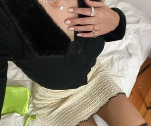 black cardigan, white skirt, and everyday look image