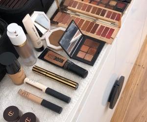 Giorgio Armani, nars, and makeup image