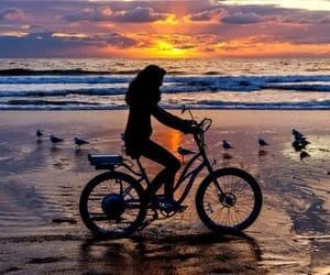 bike, sea, and silhouette image