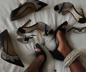 bed, black, and Jimmy Choo image