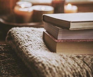blankets, book, and candles image