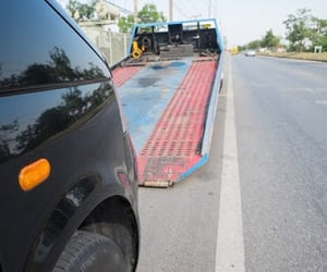 cheap towing service, heavy duty tow truck, and tow truck service image