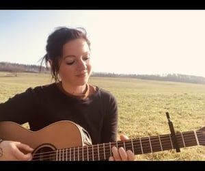 female artist, original song, and songwriter image