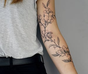 arm, flowers, and ink image