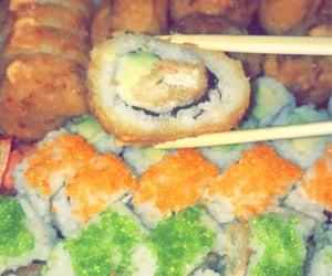 avocado, caviar, and chopsticks image