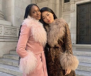asian girl, black girl, and coats image