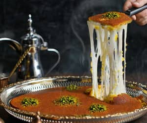 article and arabic sweets in dubai image