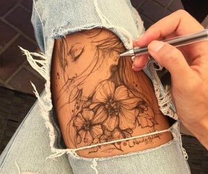 bodyart, pen, and ripped jeans image