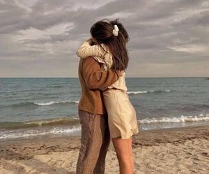 hug, couple, and sea image