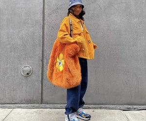faux fur, orange jacket, and street style image