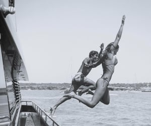 black and white, couple, and jump image