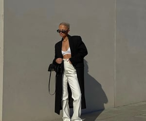 black coat, street style, and everyday look image