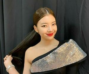 yuna, yeji, and lia image