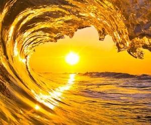 sun, wave, and sea image