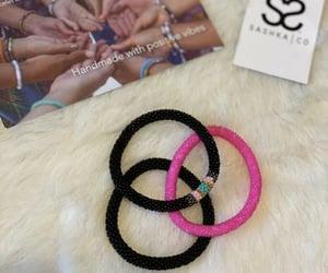 black, bracelets, and positivevibes image