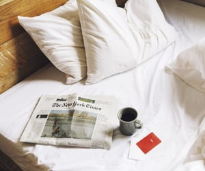 bed, cozy, and newspaper image