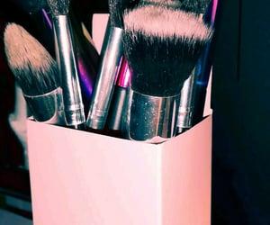 Brushes, eyes, and face image