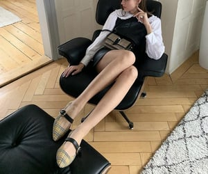 black dress, white blouse, and burberry shoes image