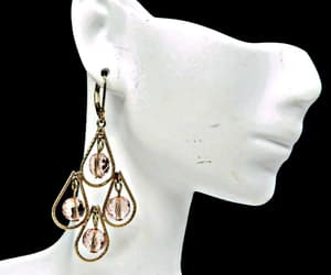 crystal, pale pink, and pierced ears image