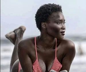 Sandy, melanin, and beach image