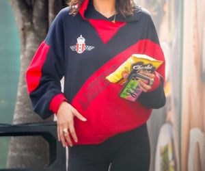 black leggings, red hoodie, and graphic sweater image