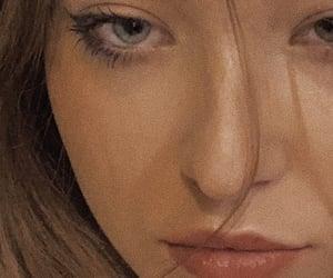 eyeliner, eyes, and frustrated image