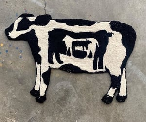 black, cow, and rug image