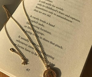 book and necklace image