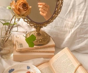book, flowers, and mirror image