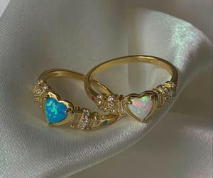 blue, gold, and rings image