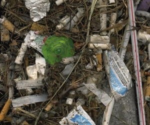 garbage, cigarettes, and dirt image