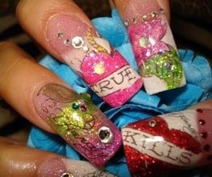acrylics and ed hardy nails image
