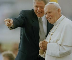 america, clinton, and katholische kirche image