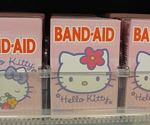 band-aid, hello kitty, and pink image