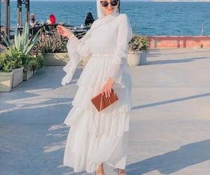 hijab and ruffle white dress image