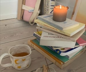 books, candle, and motivation image