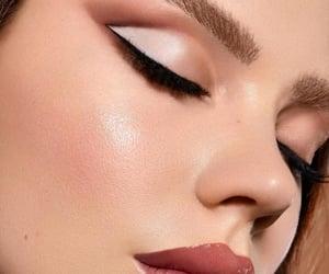 big lips, eyeliner, and makeup looks image