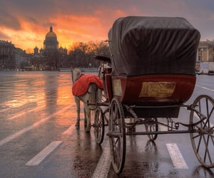 sunset and horse drawn carriages image