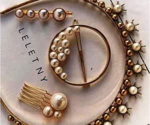 chunky headbands, blingy jeweled hair pins, and glittery headbands image
