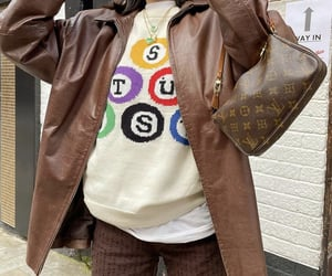 knit sweater, louis vuitton bag, and graphic sweater image