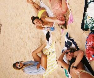 beach, sunbathing, and girls image