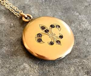 fleur de lis, locket necklace, and rhinestone locket image