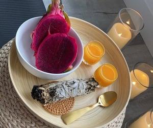 candles, orange juice, and sage image