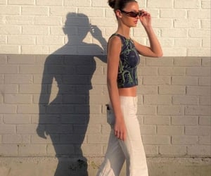 green crop top, clothes, and white jeans image
